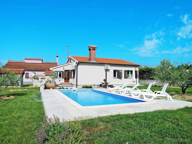 Holiday home Alka surrounded by large garden property with pool