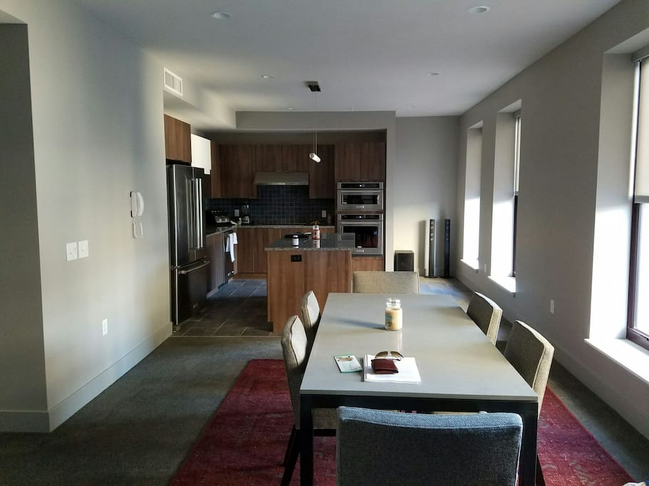An open kitchen that extends into the dinning room that sits 6. Enjoy a dinner or meeting while you overlook East 9th street.