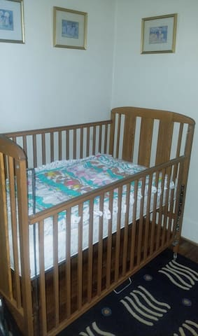 The third bedroom has a full-size crib.  Mattress pad and fitted sheets provided.  Separate window air conditioner/fan