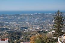 The rolling hills below Mijas gently leading to the coast and beaches