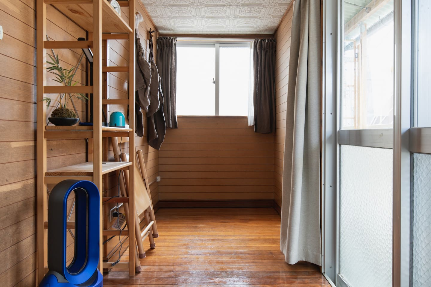 This is the single room that was available. But now there is a larger room available. The new room available has tatami  floors and it's larger.