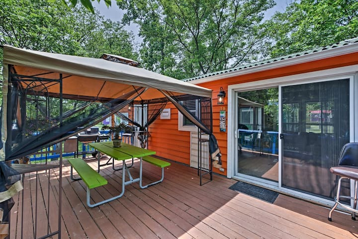 The deck features a pergola, picnic table and gas grill.