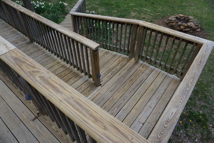 Wheelchair access ramp and adjacent fire pit.