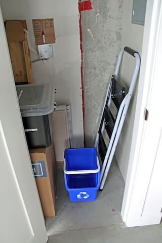 Step Stool and recycling bin in the kitchen closet