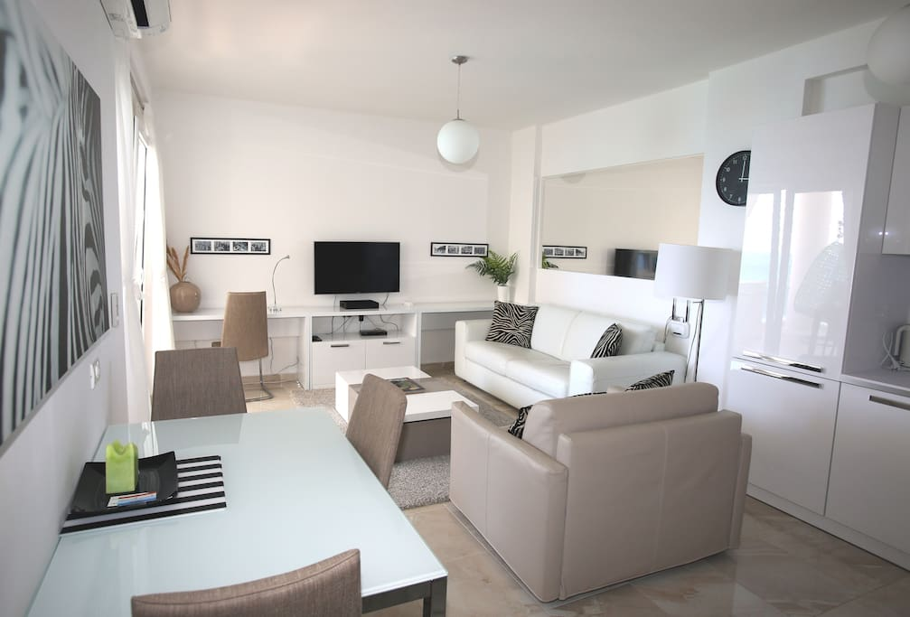 living room with the dining area