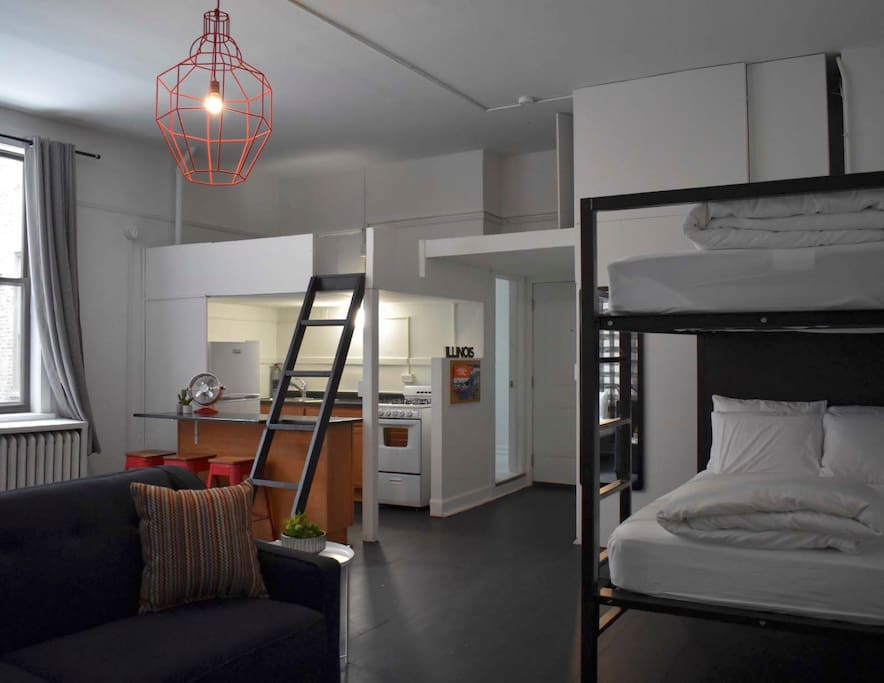 Massive ceilings mean the loft possibilities are endless - and just on the other side of the kitchen is a private bathroom