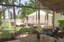 Enjoy a Belikin beer under a shaded palapa in the gardens.