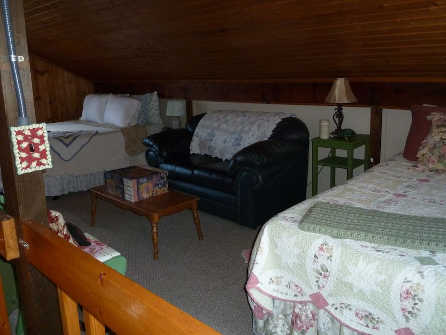 lofted bedroom with two queens and one full bed