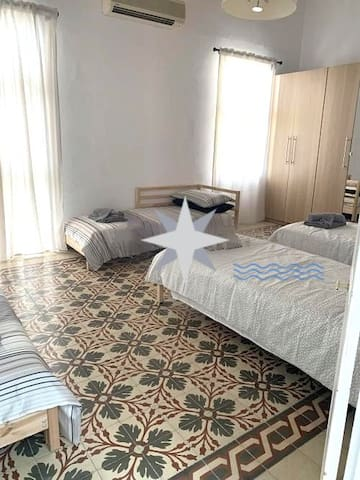 This room can be booked up to 4 persons, but beds will be removed in case it will be booked for a couple (example)  I has an own balcony and airconditioning, as well a huge closet and other amenities.