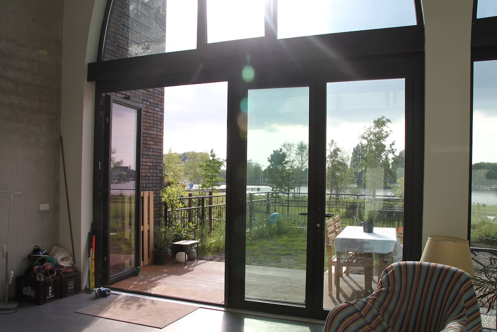 Front windows/door with a view on the Amstel