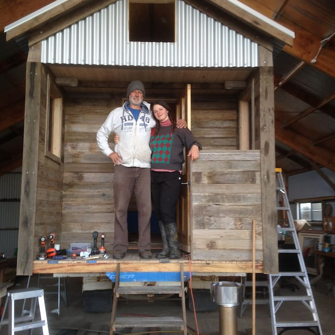 Rob and daughter Madelaine standing on the back verandah of the blue truck house