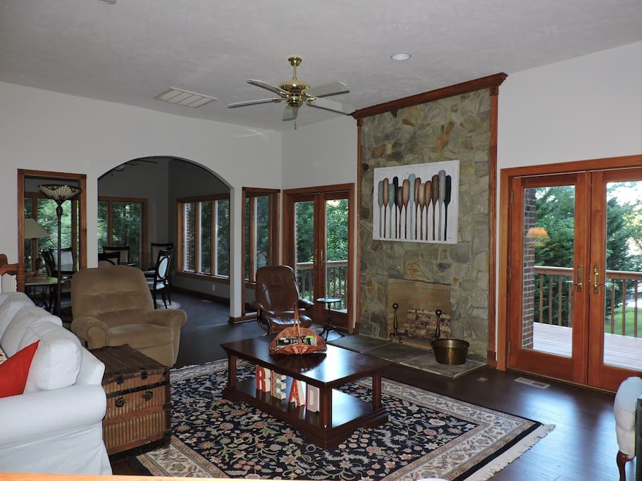 Stone fireplace, dining to the left, kitchen to the right, tables seating 16