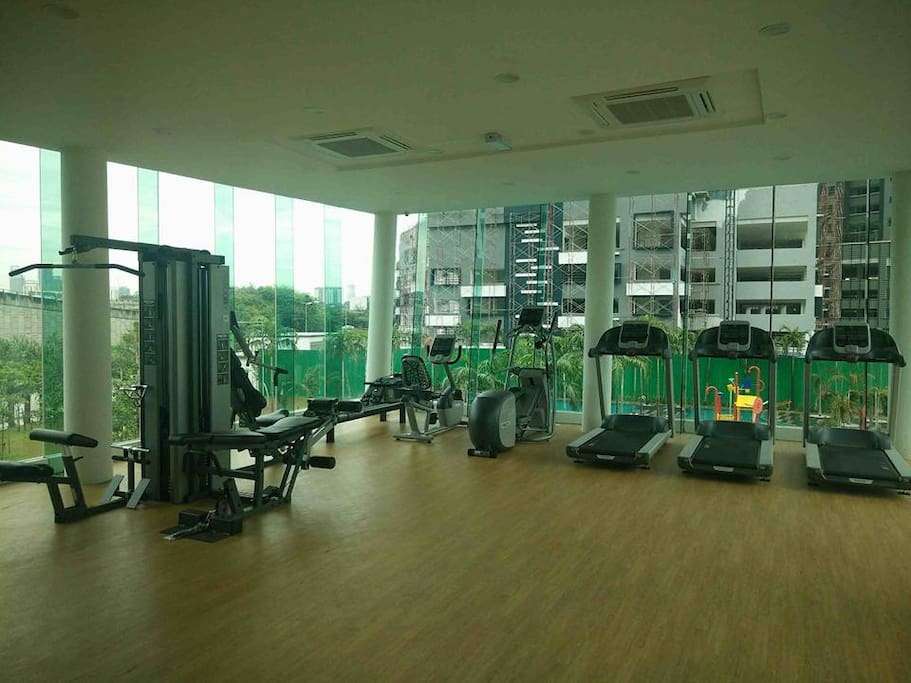 gym facilities overlooking the pool