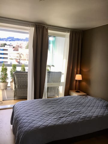 Bedroom 2 has a large double bed. There is also access to the balkony with a nice view to Strandafjellet.
