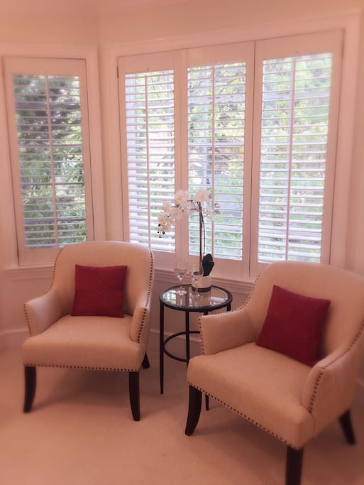 "Enjoy your morning coffee or evening glass of wine in the private sitting area ""This place is AMAZING! The room is beautiful and had everything we could ever need."" – Regan"