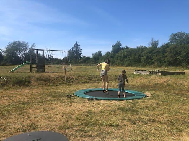 A big trampoline, swings, slide and huge garden to roam around