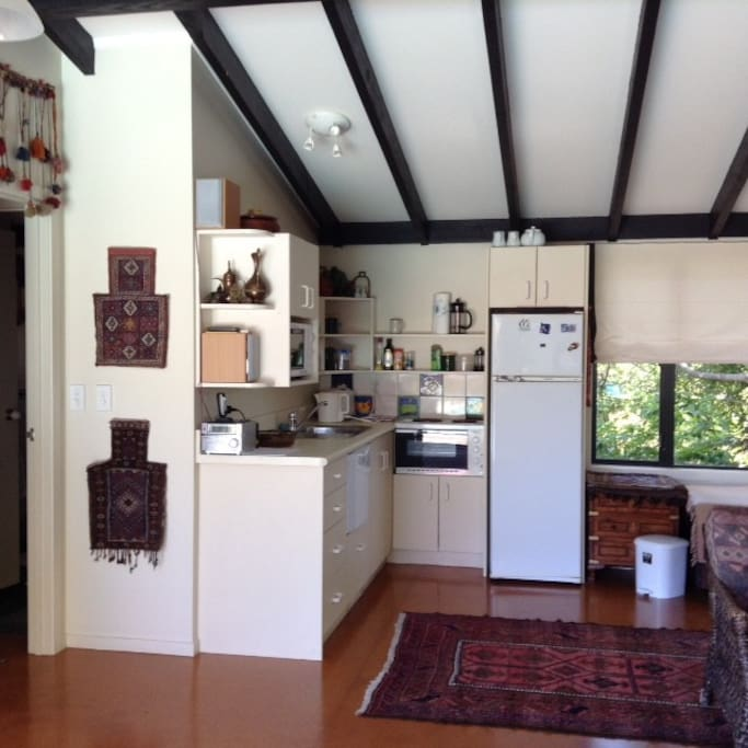 Small kitchen area for self catering, small cooker, microwave, fridge/freezer and dishwasher