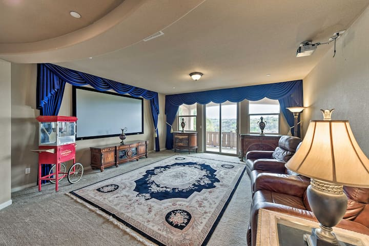 The home theater features a popcorn machine, projector, and large screen.