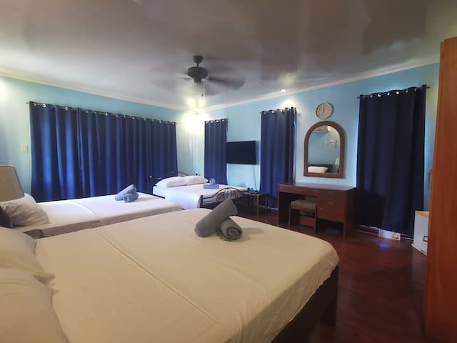 ROOM C. Located at the 2nd floor. 3 Queen Sized bed with Toilet and Bathroom.