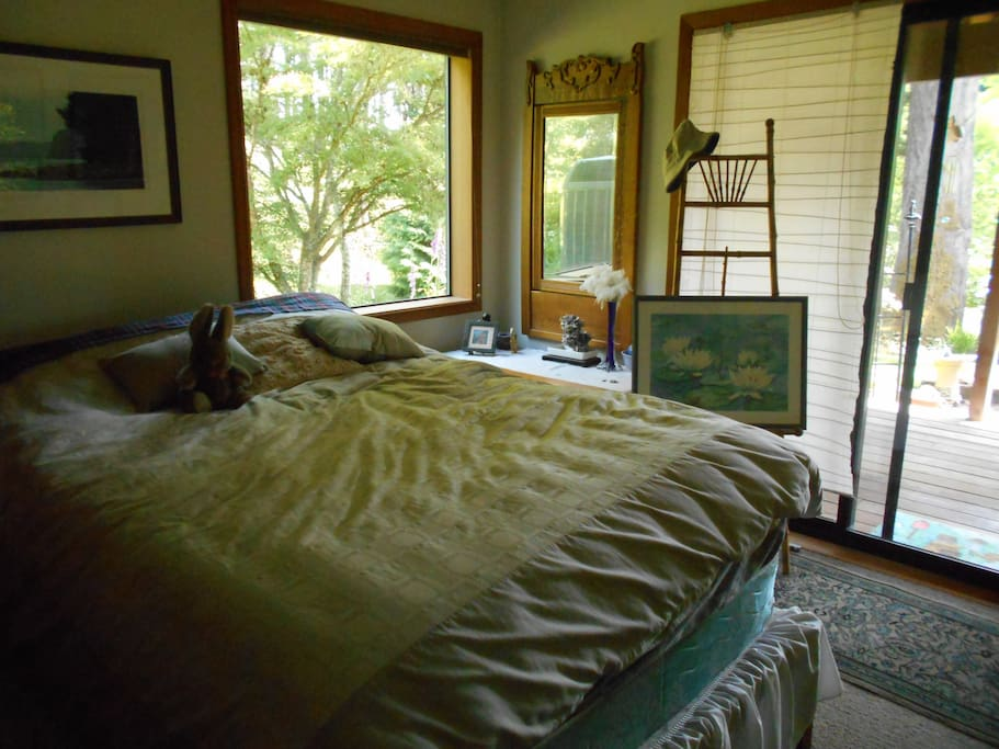 Comfy queen bed with slider to private deck. Private access to your room.