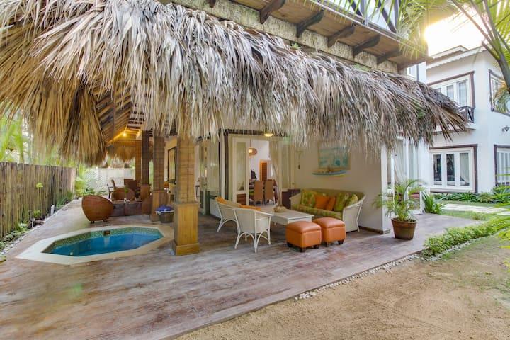 Tropical villa next to the beach, boasts peaceful surroundings & jacuzzi tub!