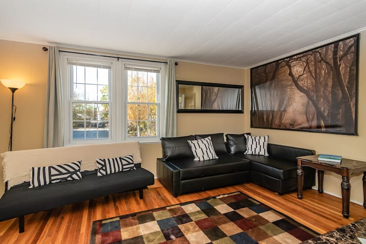 Light & bright living room to cozy up in - sofa doubles as a sleeper! Like our furnishings? See kit.co/curranlodging