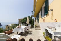 Our beatiful big private terrace sea view with a garden of lemon trees!