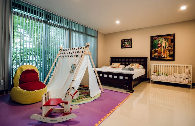 1st Floor. Bedroom 4 with Kid toys. This room connected with Bedroom 3 and has straight entrance to backyard with swimming pool. Room has Aircond, babybed, wardrobe, soft toys and bunk bed for kids