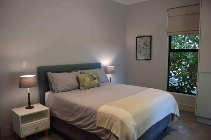Queen bed in second bedroom with built in wardrobe