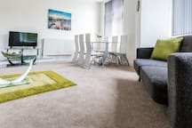 Large lounge area with Wi-Fi, TV and ample space to rest and relax