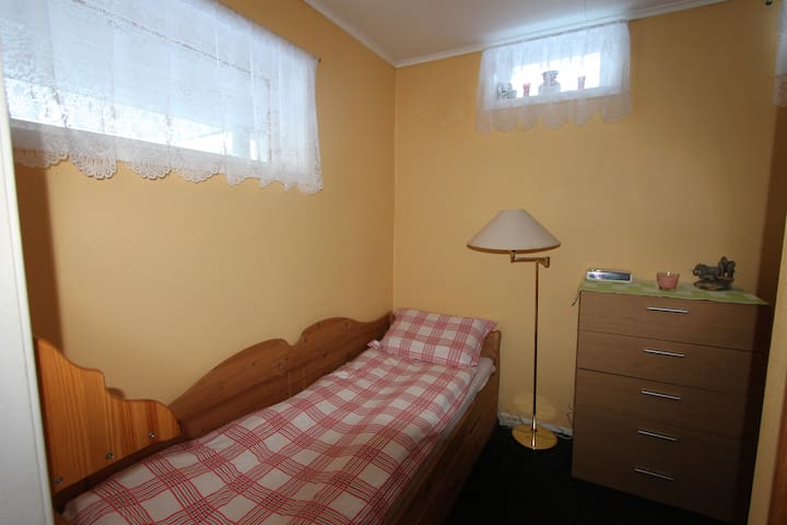 A small bedroom with single bed