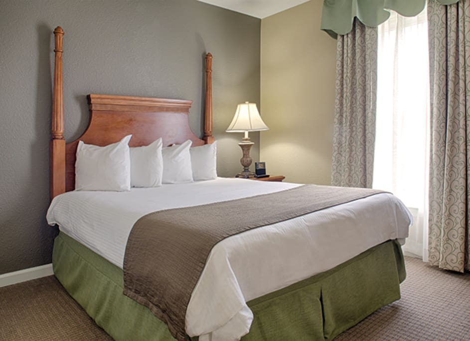 Master Bedroom with Queen Size Bed. Please note layout and decor vary.