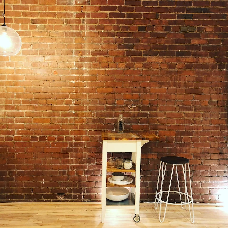 Exposed brick reminiscent of Montreal homes from the turn of the century.