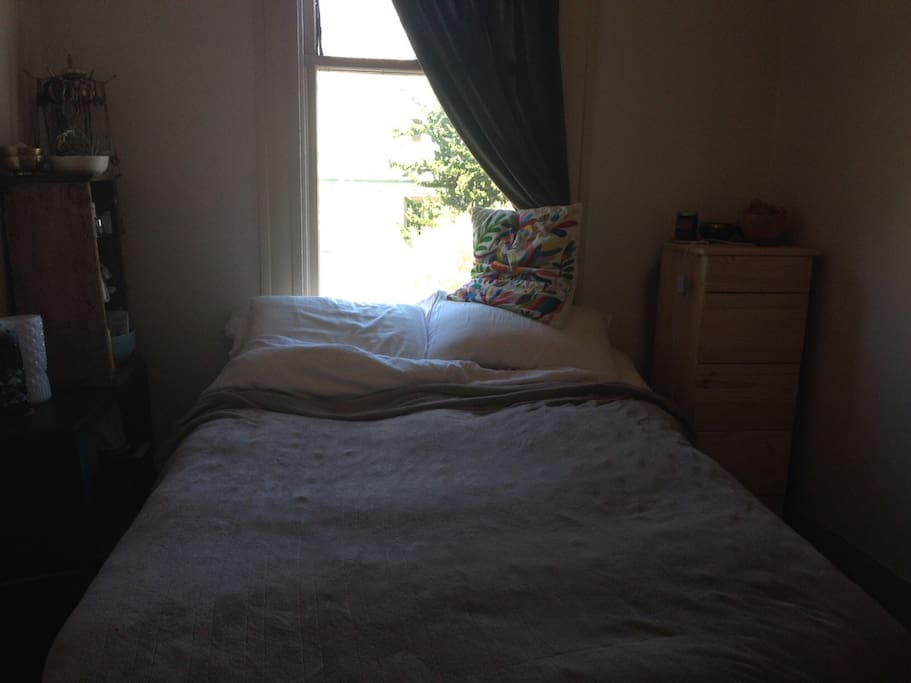 Queen bed with a beautiful window