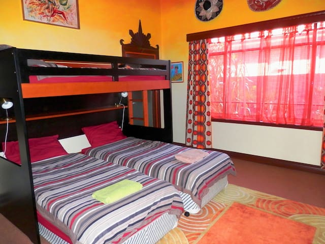 Tiki Calypso bedroom with 3 single beds