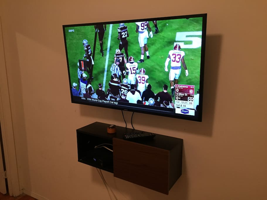 Mounted 50 inch Smart TV with cable