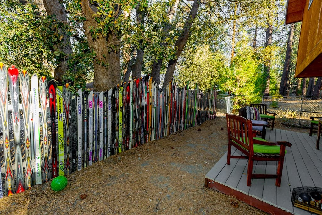 My husband & I custom built this ski fence in the back yard. Play horseshoes back here!
