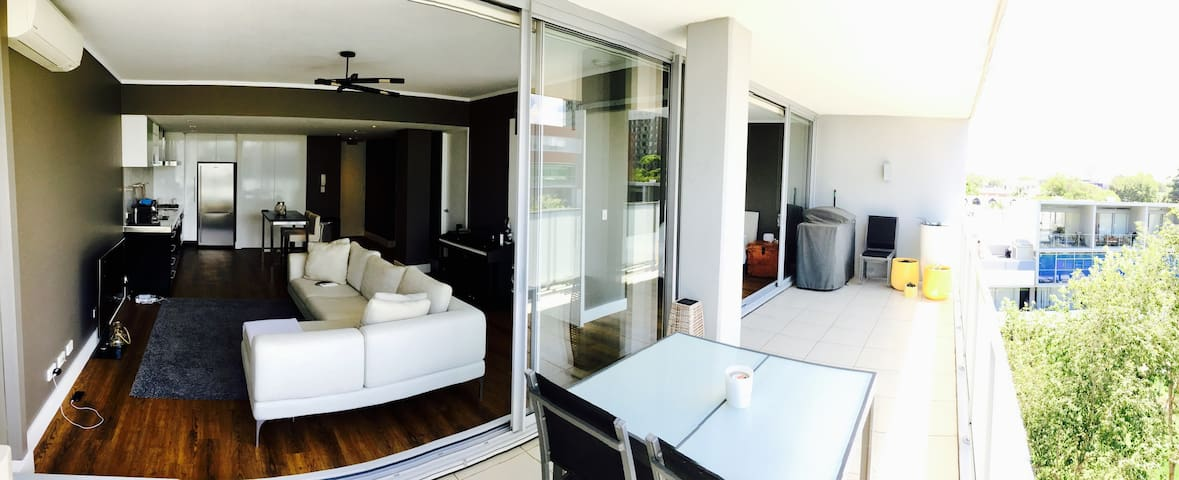 Here is a Pano. shot of most of the apartment taken from the balcony