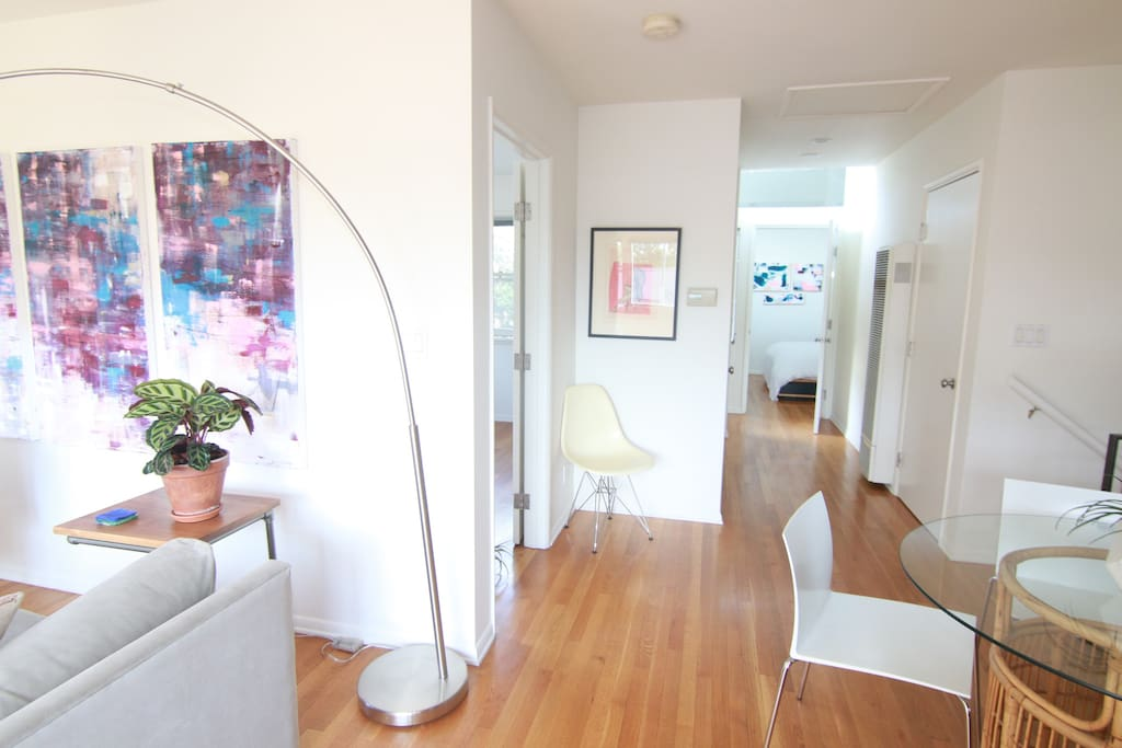 View of hallway leading to two bedrooms and bathroom