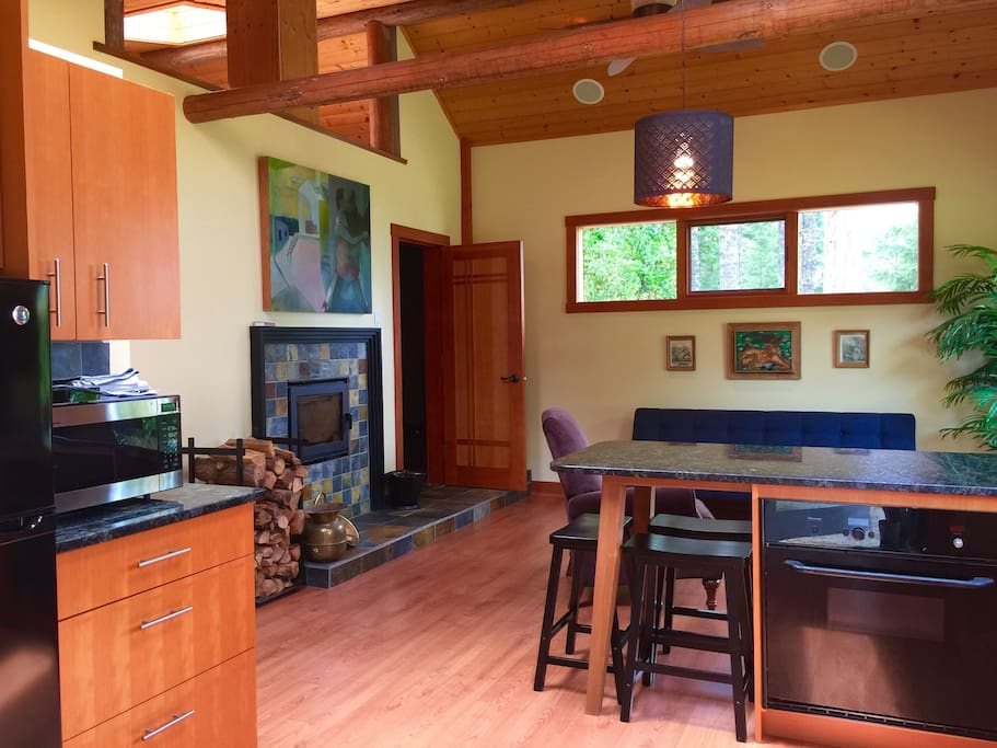From kitchen breakfast bar looking into living room.