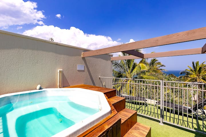 Take a dip in the pool or the rooftop spa