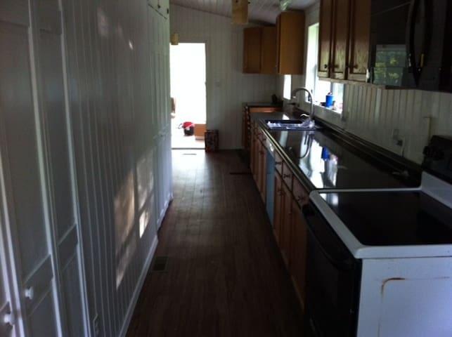 Galley built in Kitchen, Pantries, Range, Microwave, Dishwasher, drop down desk/charging station
