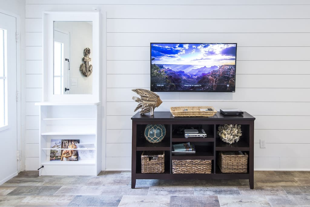Opposite Wall in living area. Flat Screen TV with dvd and cable