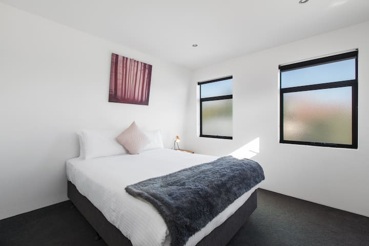 A guest bedroom has built in wardrobes, a queen bed with quality linen and reverse cycle heating and cooling