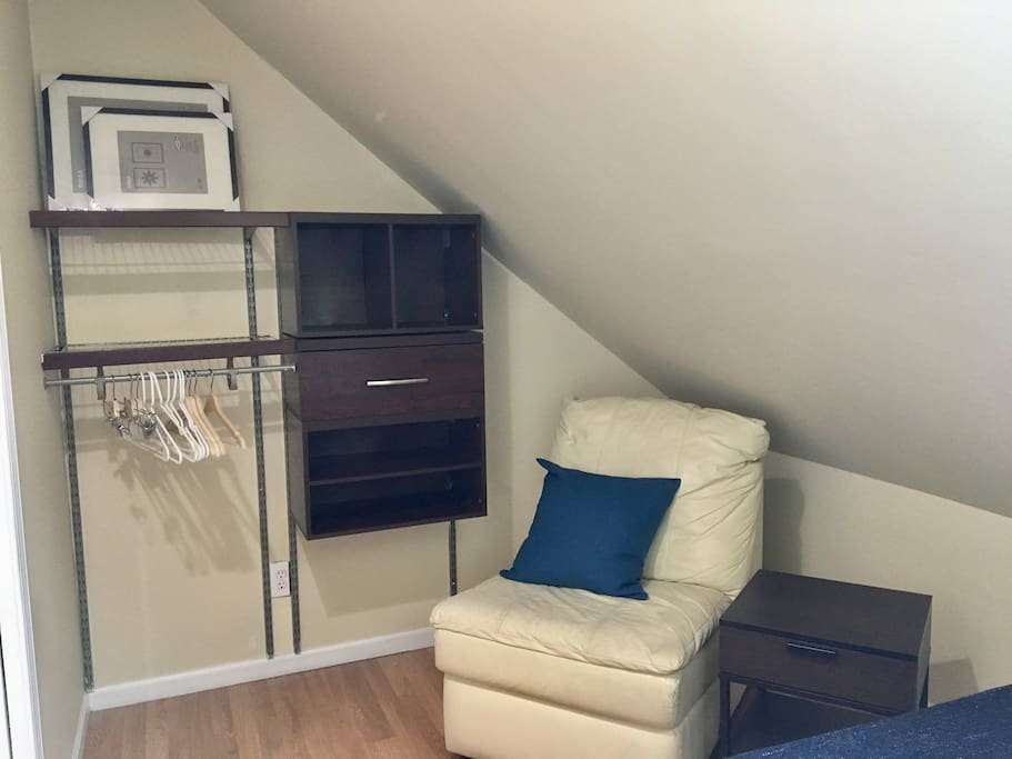 Closet system gives you hanging space and a reading chair makes your room cozy.