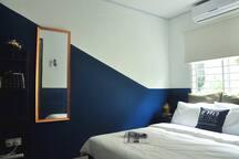 Queen sized bed in cozy room.