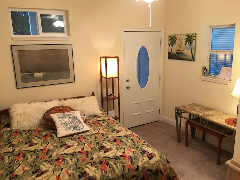 Private entrance into your guest suite with wall to wall carpeting in the bedroom.