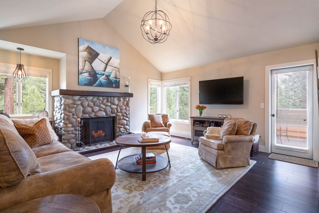 "Our cozy living room, furnished in Tahoe style, offers a Queen-size sleeper sofa, swivel rockers that you could spend the day in, a work station with views of the Sierra pines, a wood-burning fireplace, a 48"" flat screen HD TV and a deck with outdoor pub-style seating."