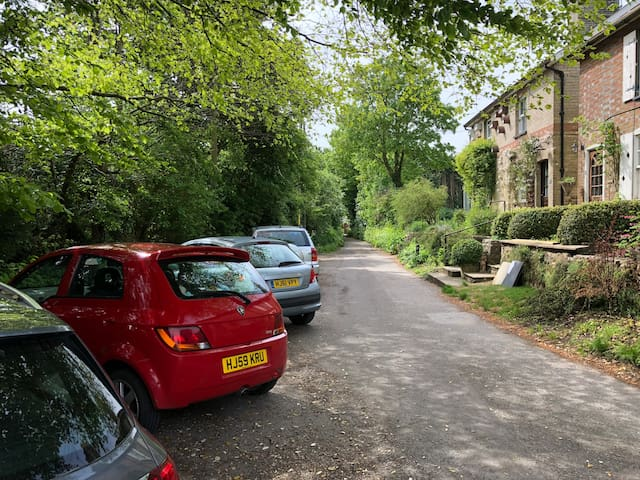 East Walls, the lane has unrestricted parking in front of the cottage, although not guaranteed it is unusual not to be able to find space there or a short walk away. You shouldn't need to pay for parking.