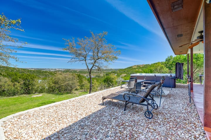 Enjoy lush Hill Country views from my balcony! High end patio furniture, dining height fire table, and spa.